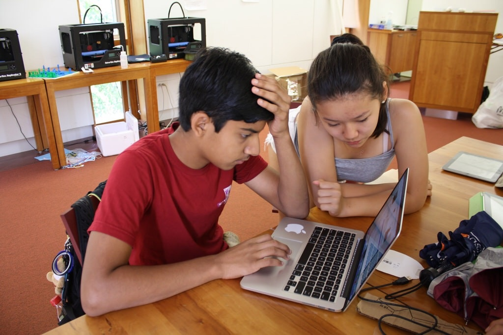 Sean and Sarah debug the code for a tie that changes color to match your shirt.