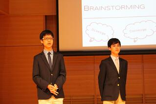 Partners Elliot and Jared present their brainstormed ideas