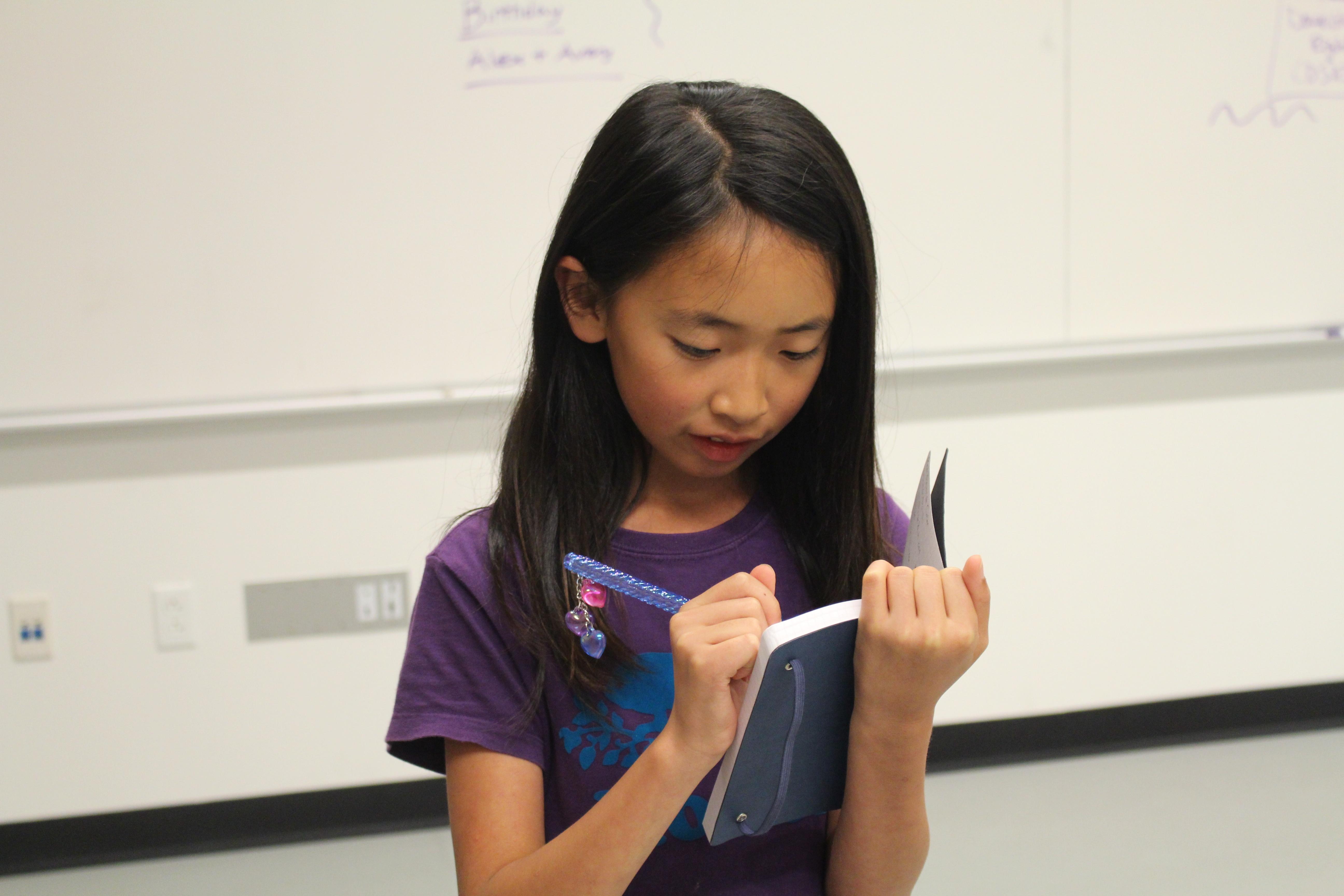 Jennifer takes notes preparing to speak in Communications class