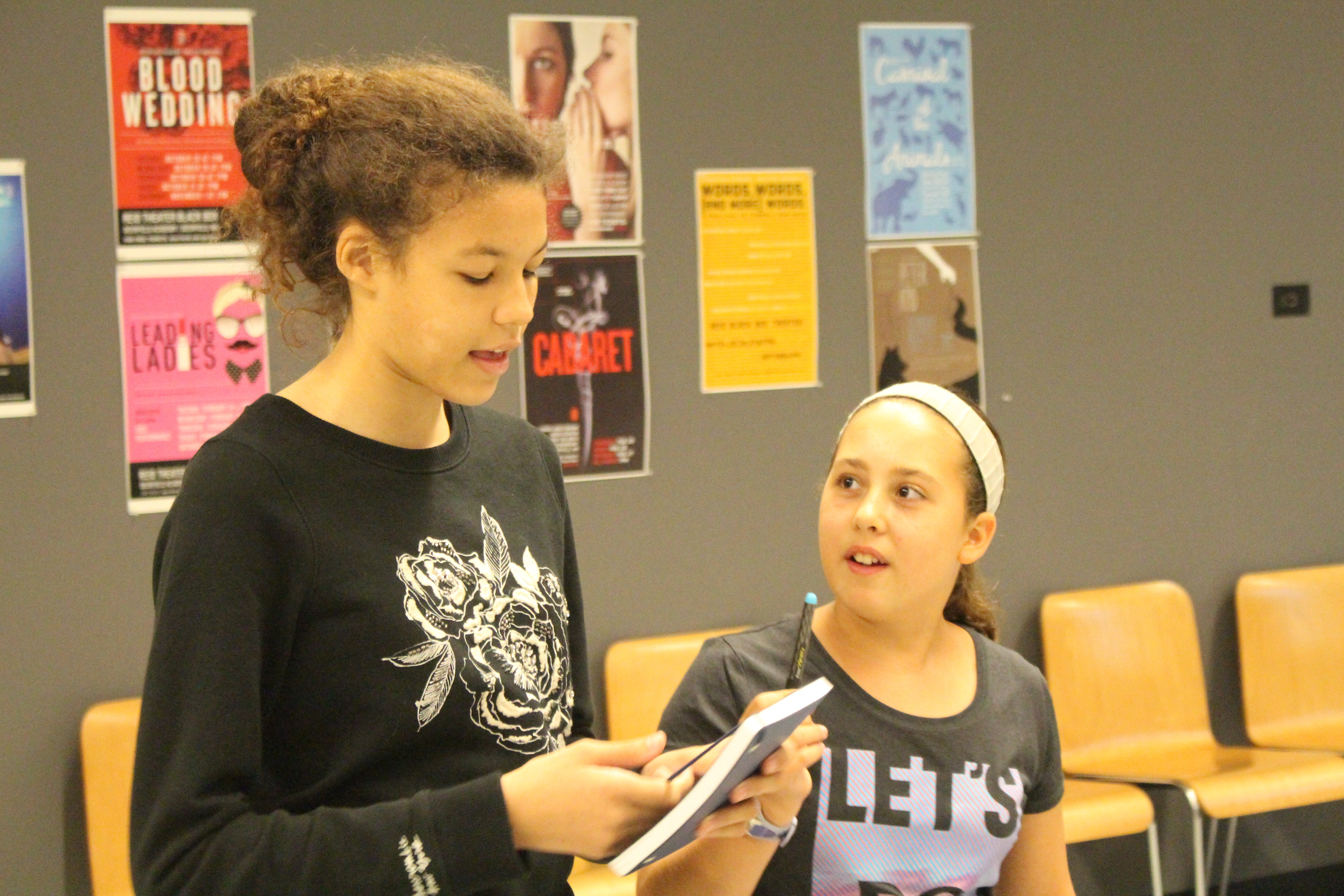"""Two students rehearse their lines for their Communications """"Sell Your Friend"""" Project."""
