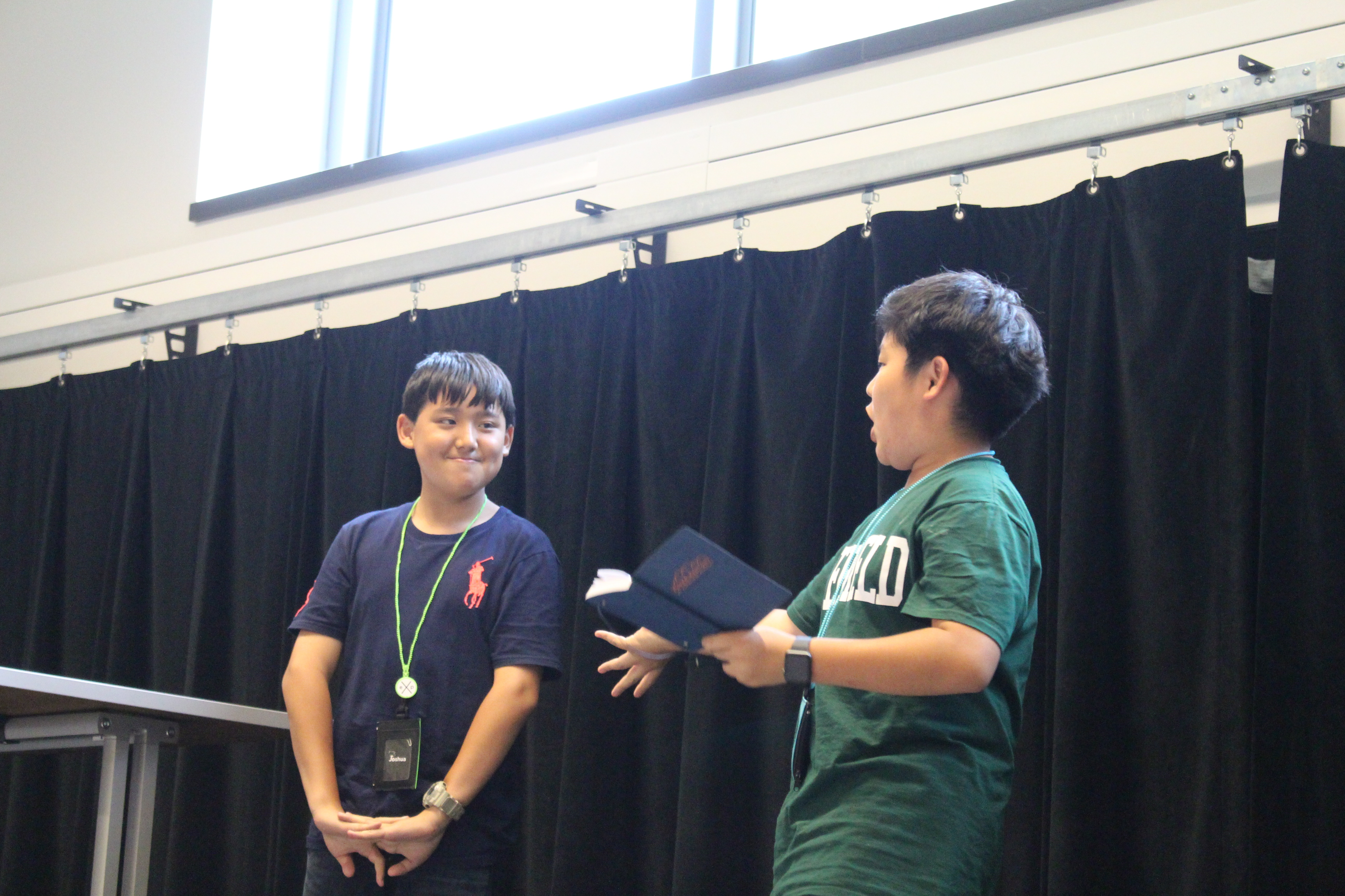 Brandon enthusiastically presents Joshua to his Communications Class.