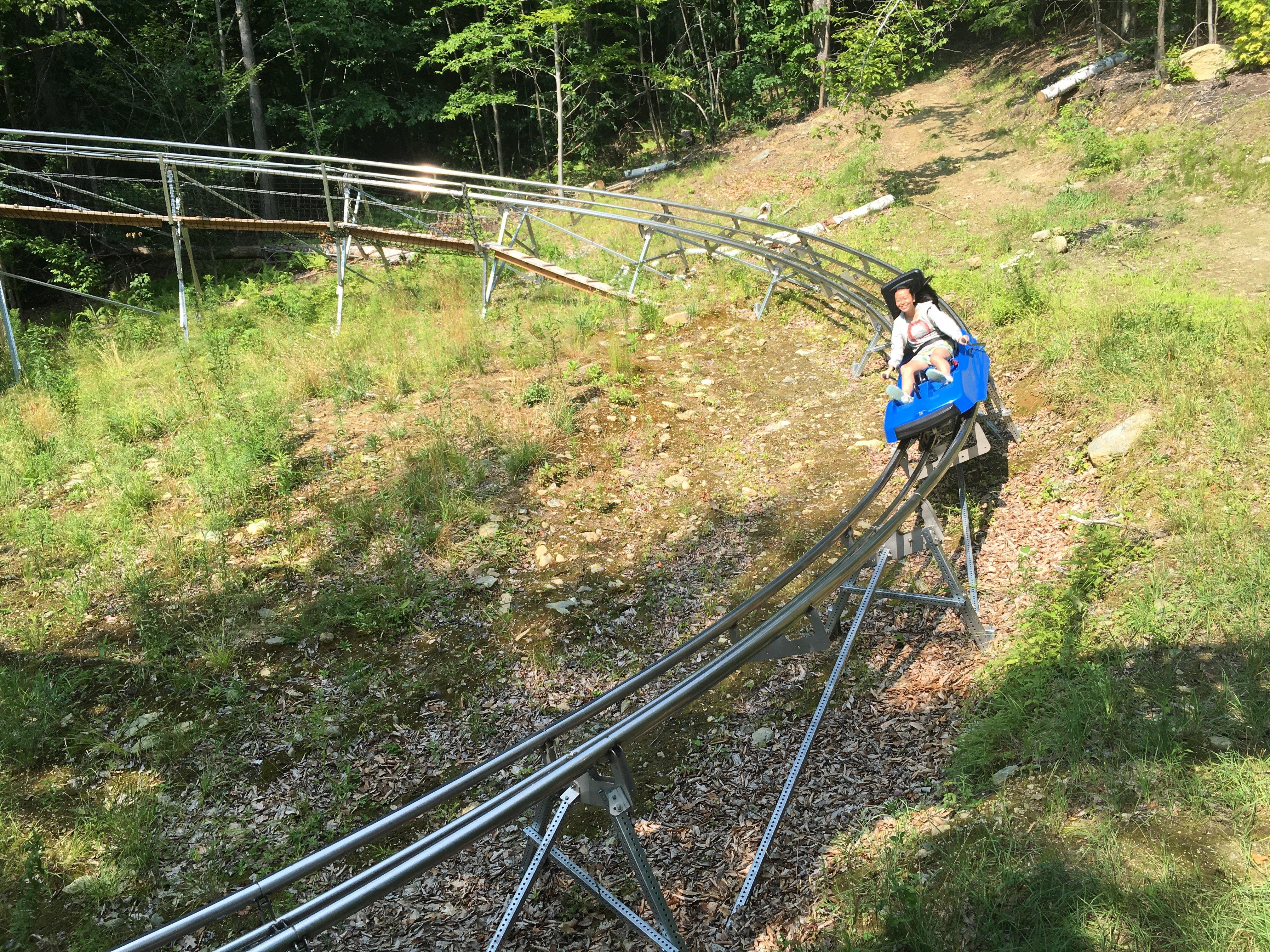 International student Natasha speeds down the mountain coaster at Berkshire East.