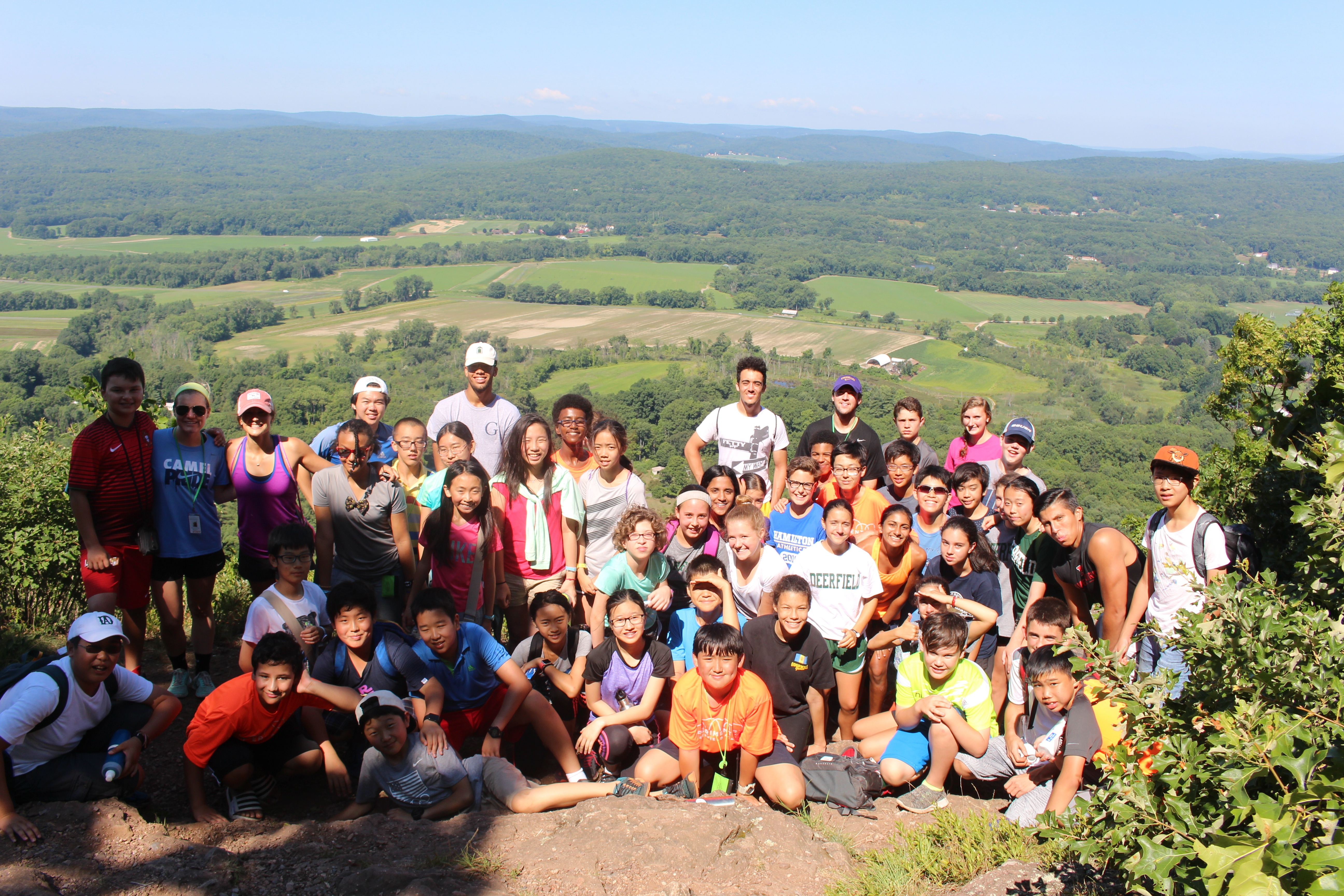Experimentory middle school students and staff pose overlooking Deerfield and the Pioneer Valley.