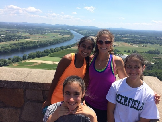 An Experimentory Proctor poses with three eighth grade girls at the top of Mt. Sugarloaf.