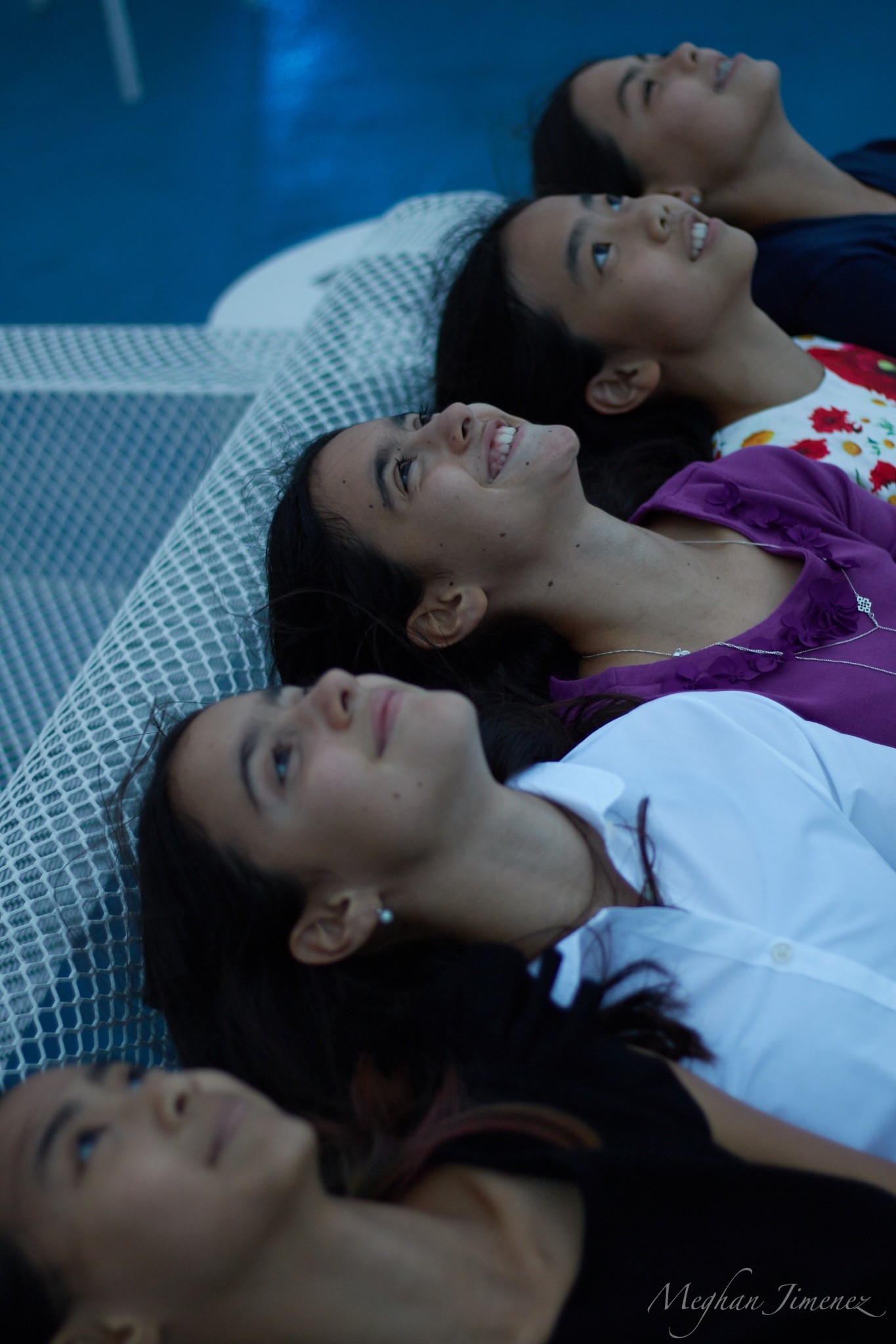 A group of seventh and eighth grade girls admire the sunset on the cruise