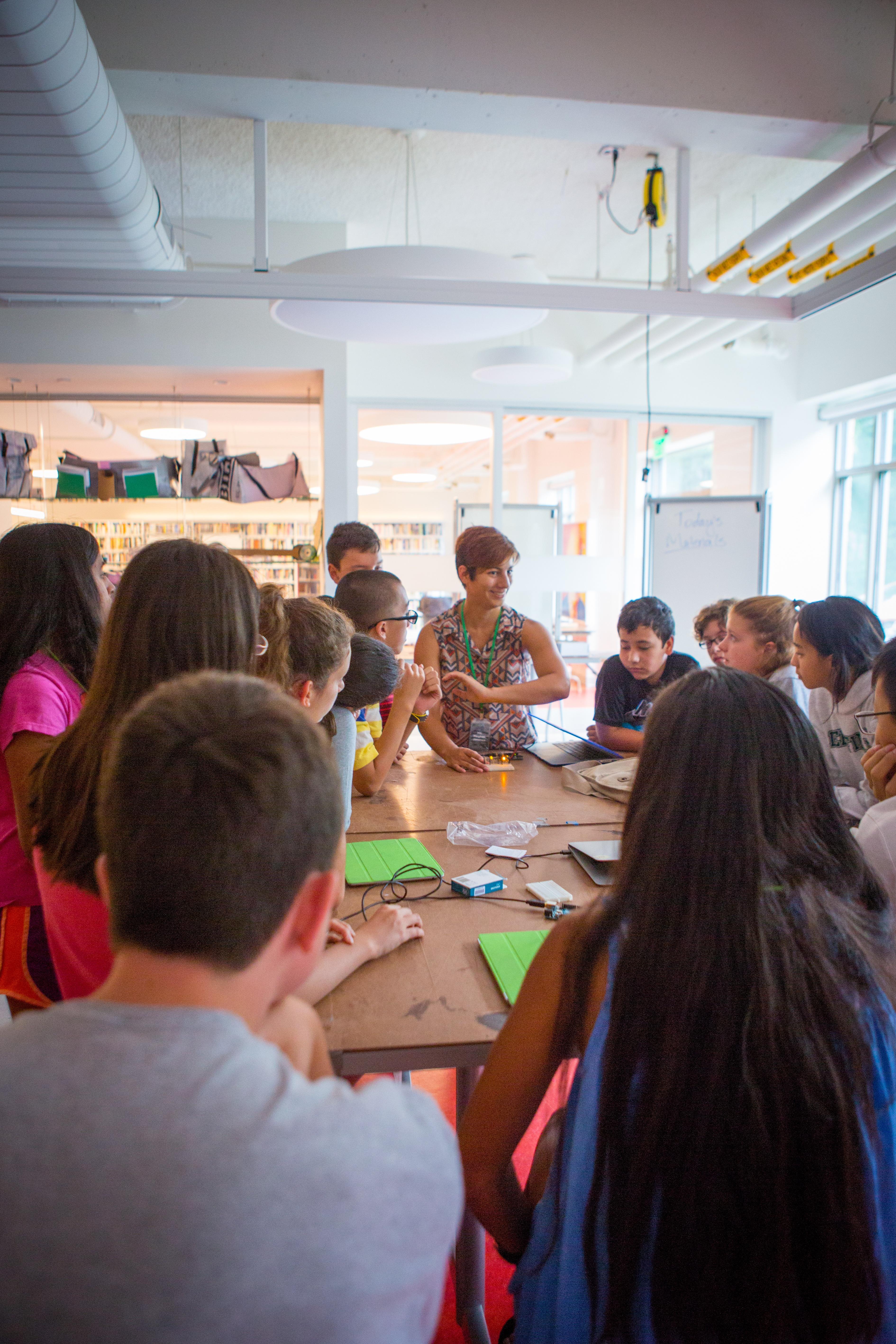 Electronics Teacher Ms. Jimenez explains the finer points of constructing a circuit board.