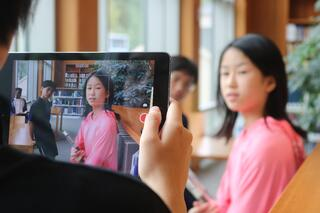 Students filming a video in Deerfield's beautiful Boyden Library.