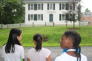 Seventh grade students study the architecture of one of the historic buildings along Old Main Street in Deerfield.