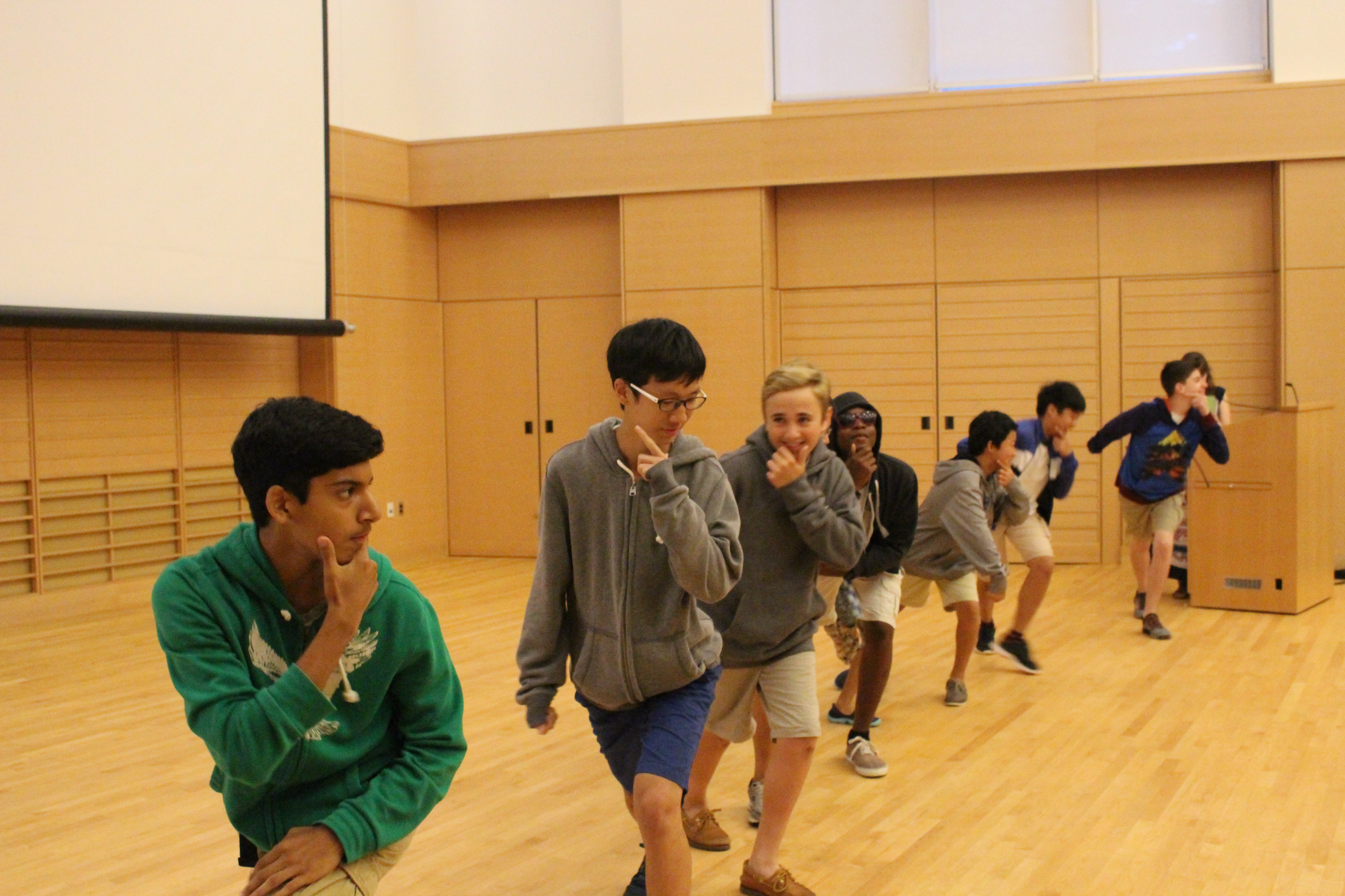Eight boys strike a pose while dancing during the Talent Show.