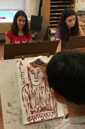 William creates Alex's likeness using glue and glitter