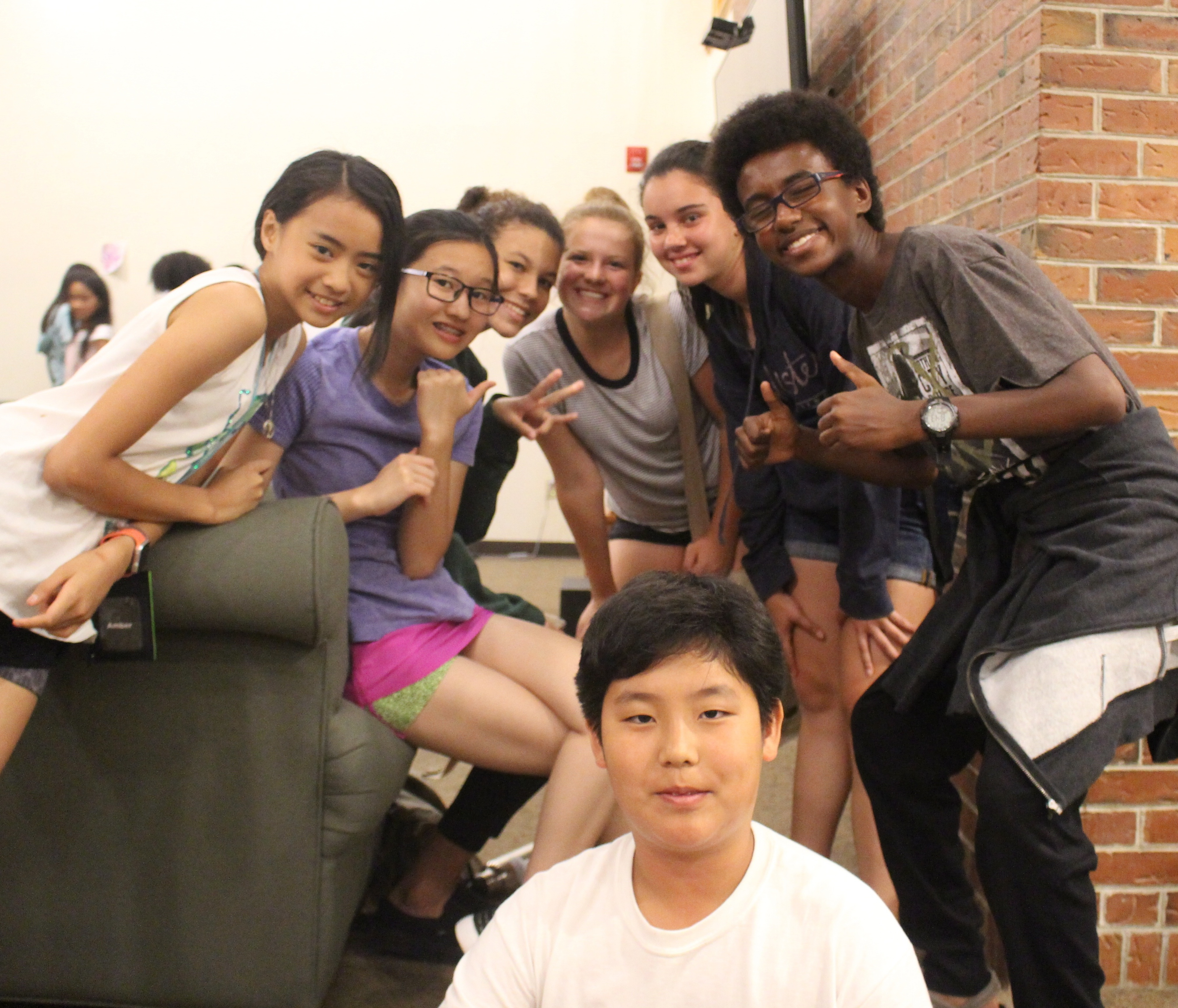 A group of Experimentory students hanging out in the central common room shared by the boys' and girls' dorms.