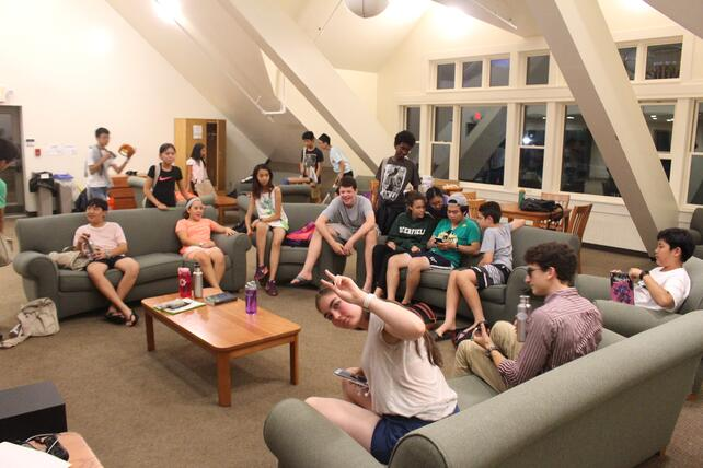 Middle school students and proctors chill together in the dorm common room