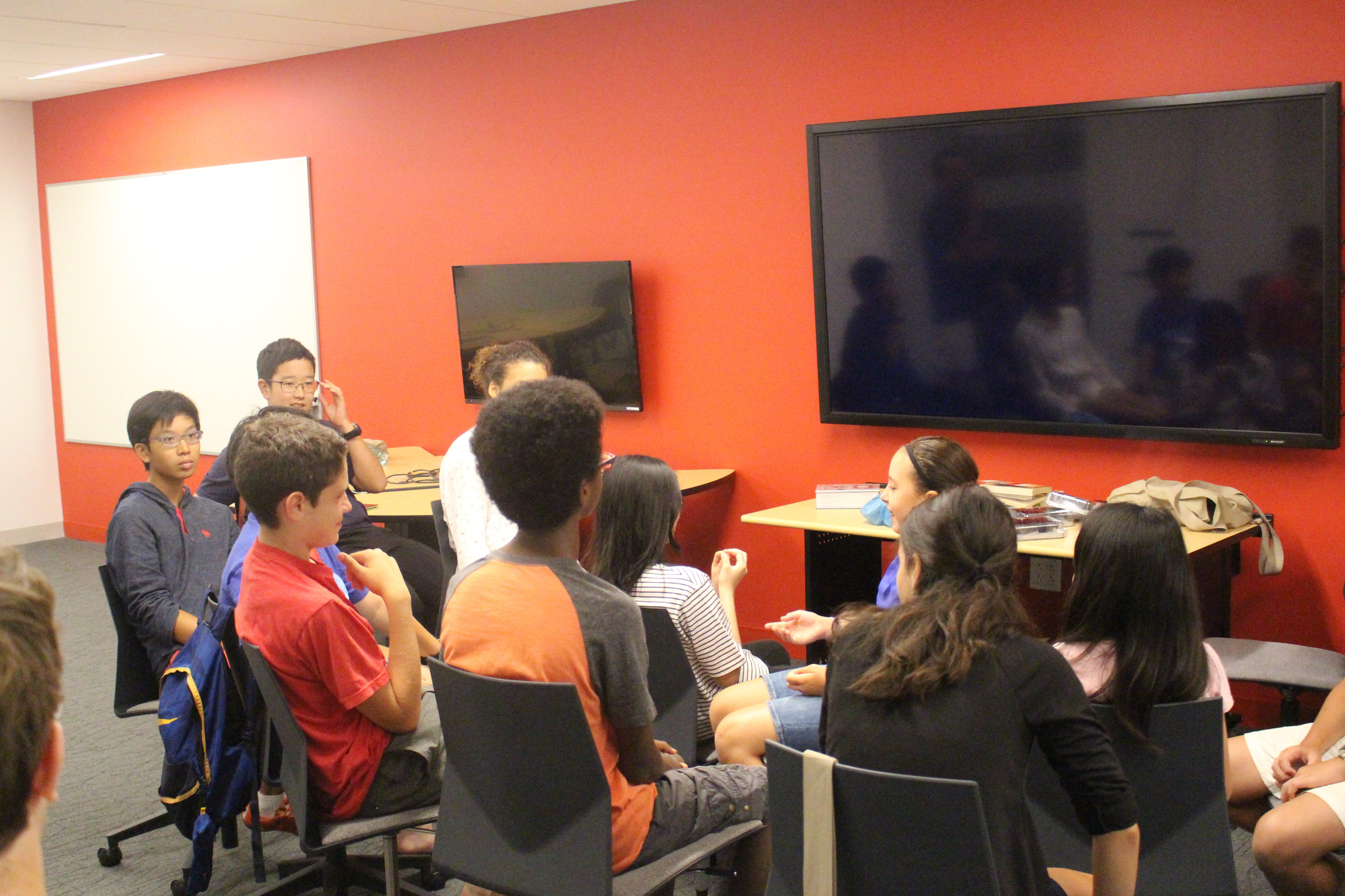 Seventh and Eighth Graders settle down to watch the debut of their classmates first films.