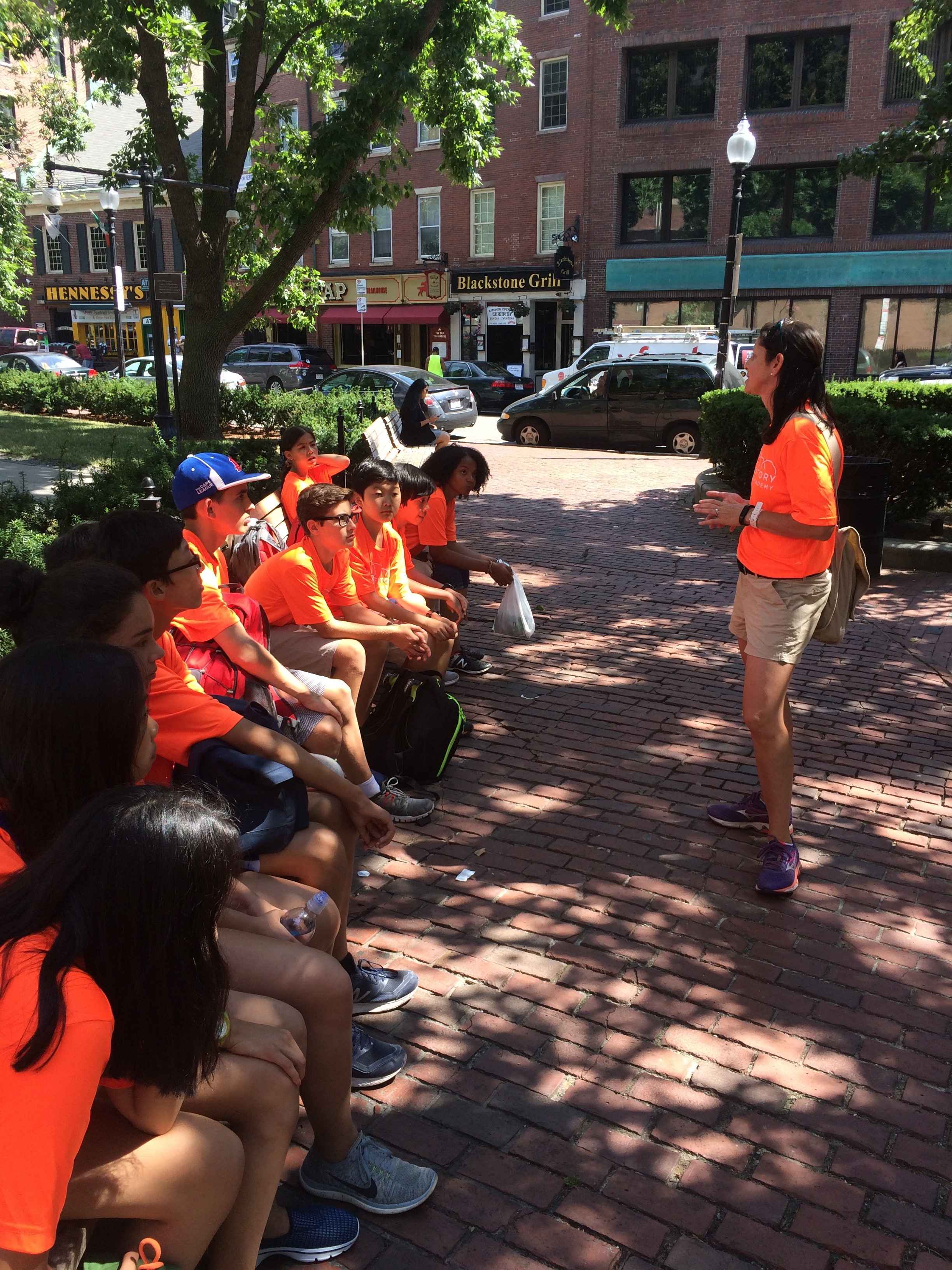Architecture + Culture teacher Ms. Sherburne instructs students in Boston Common.