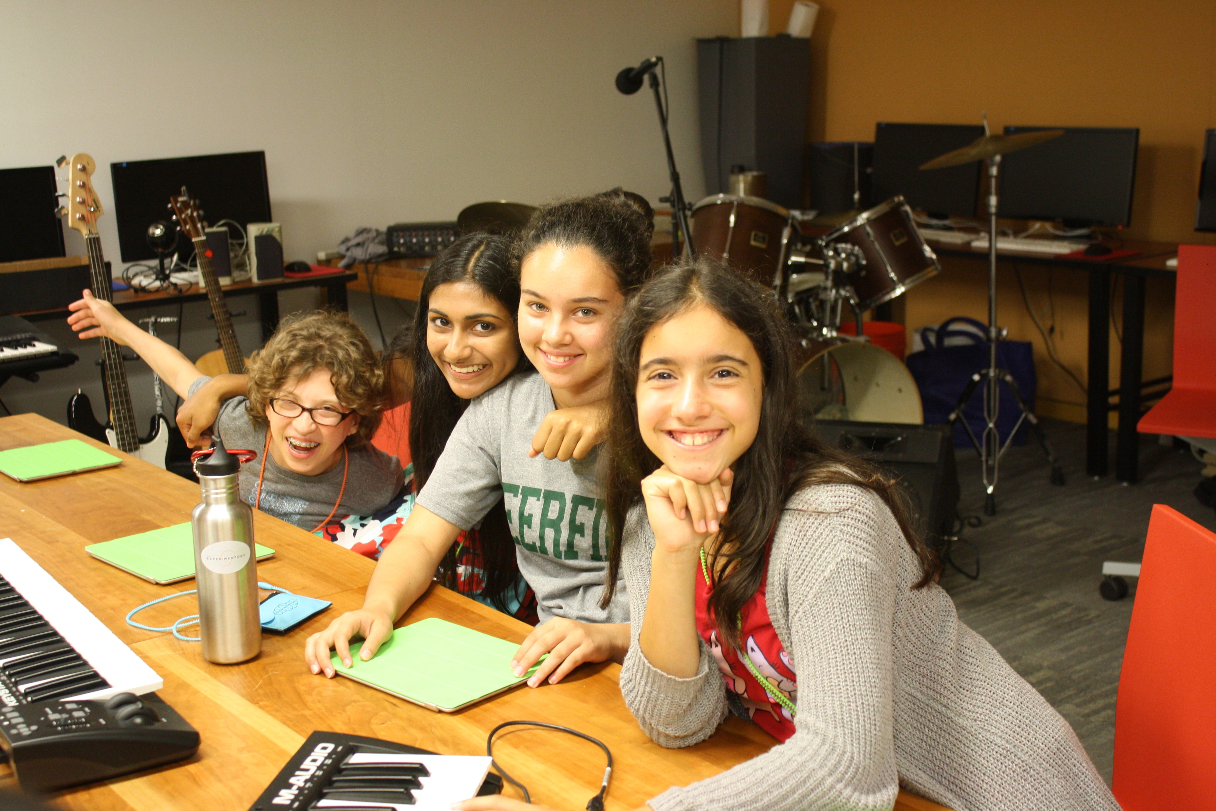 Some eighth grade girls having fun in composing in Garage Band in Music + Film class.
