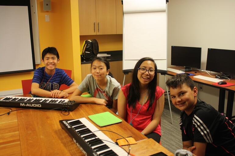 Kevin, Natasha, Amelia, and Abram working on music compositions