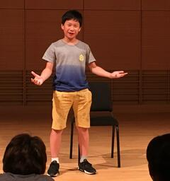 Seventh grade student Qiheng performs a theater scene on stage