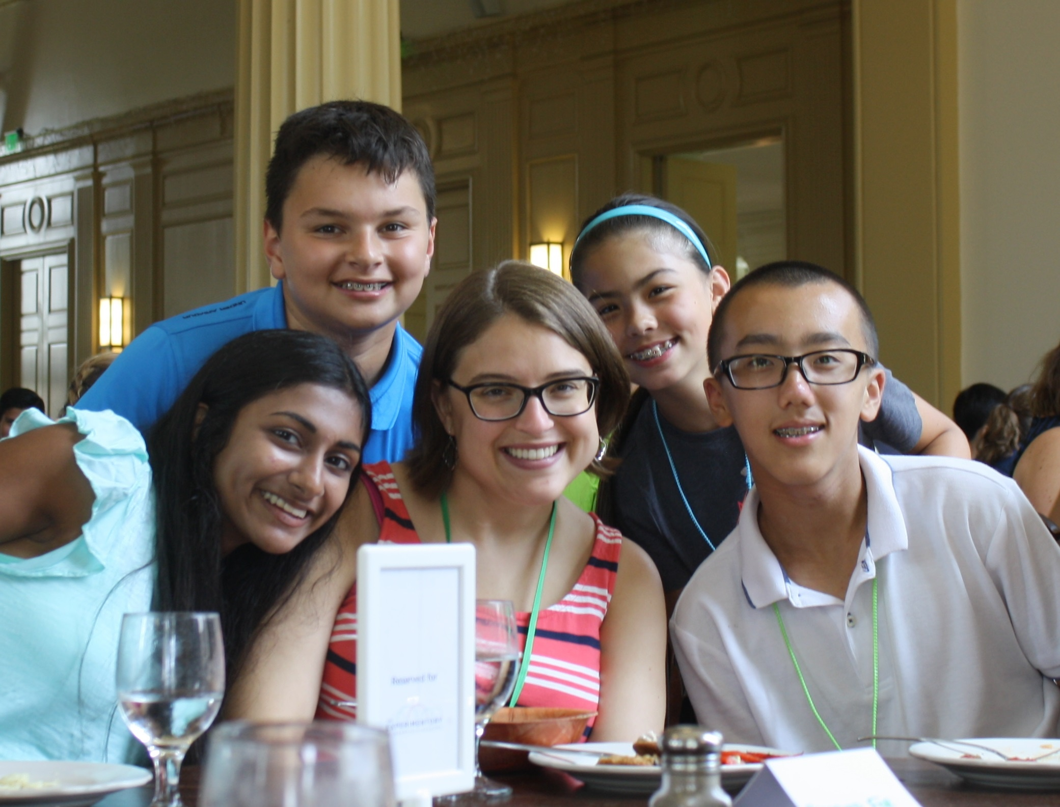 Ms. Schaffer with a group of students at a sitdown lunch