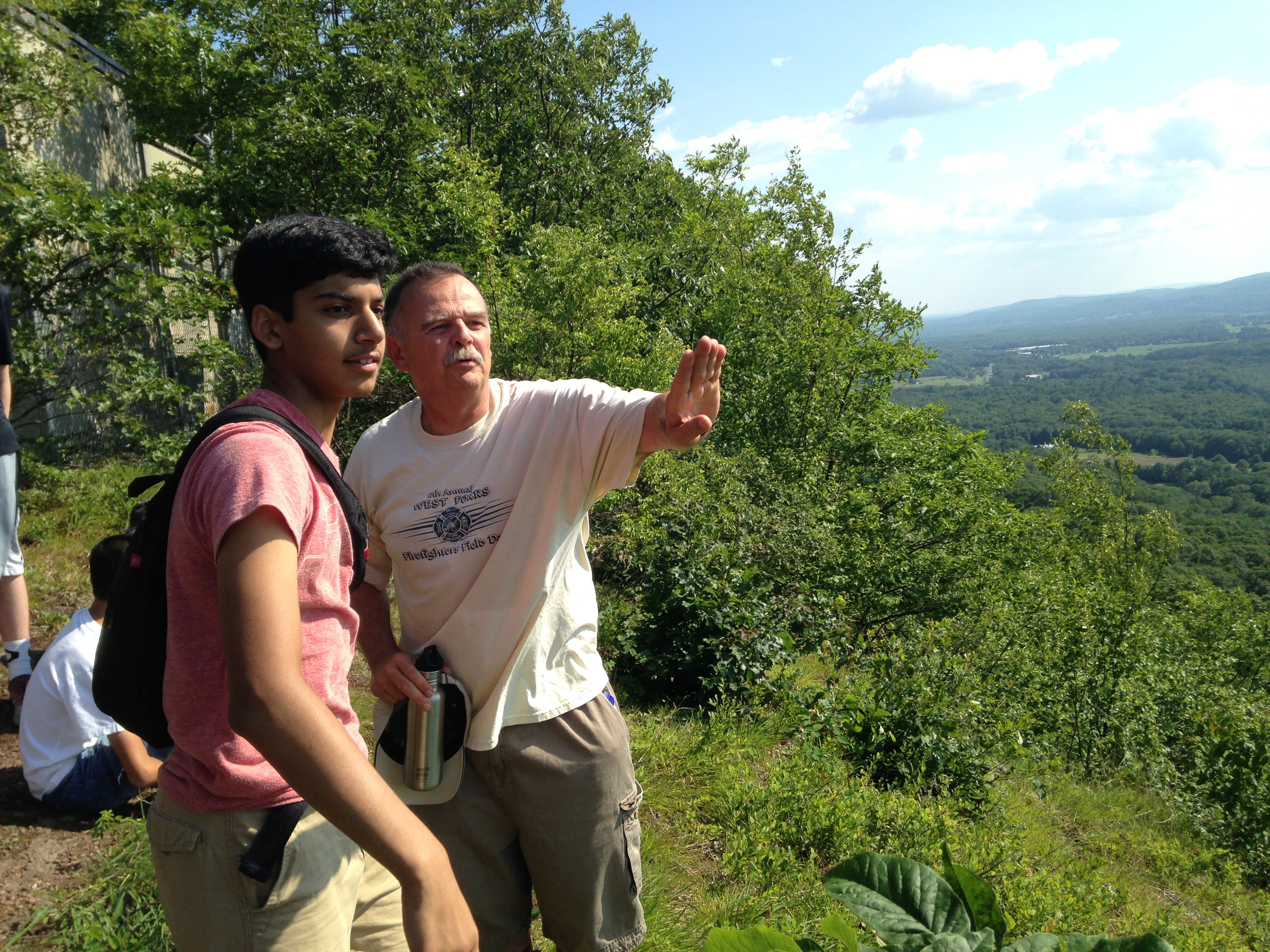 Head of Community Life Mr. Kelly tells Sean the history of the Pioneer Valley on a hike during Experimentory 2015.