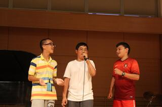 Jason, Jonathan, and Abram sing acapella in the annual talent show