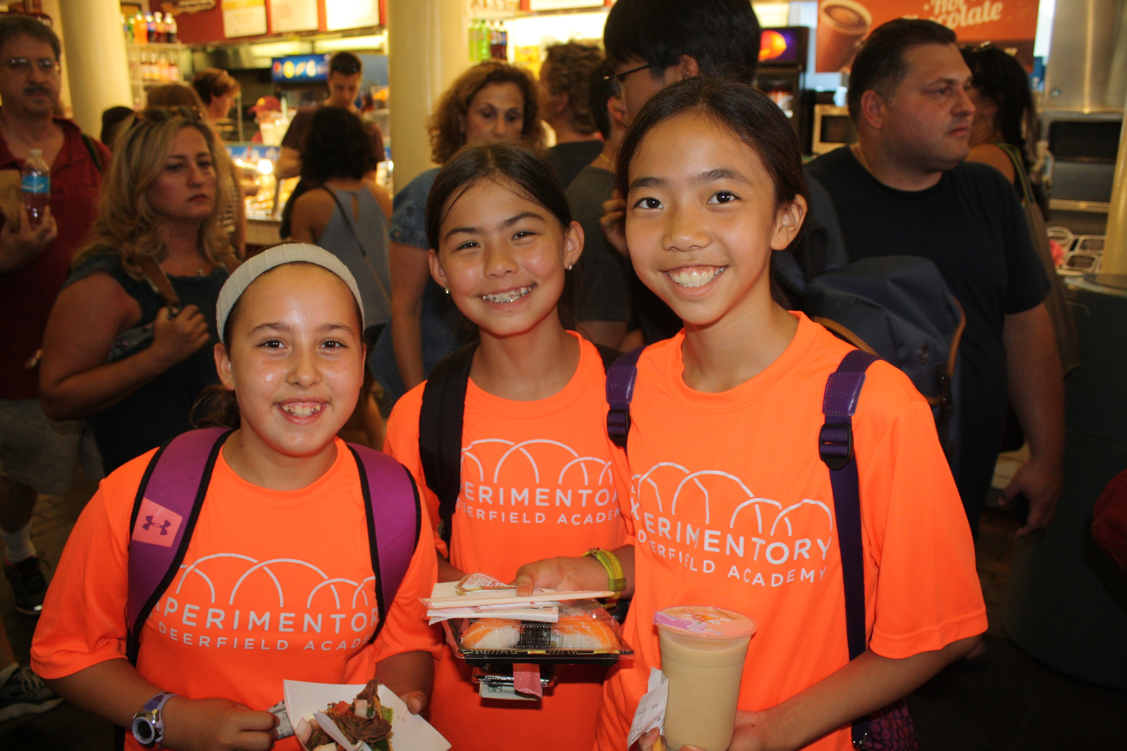 Bella, Lucy, and Serena with their food from the food court.