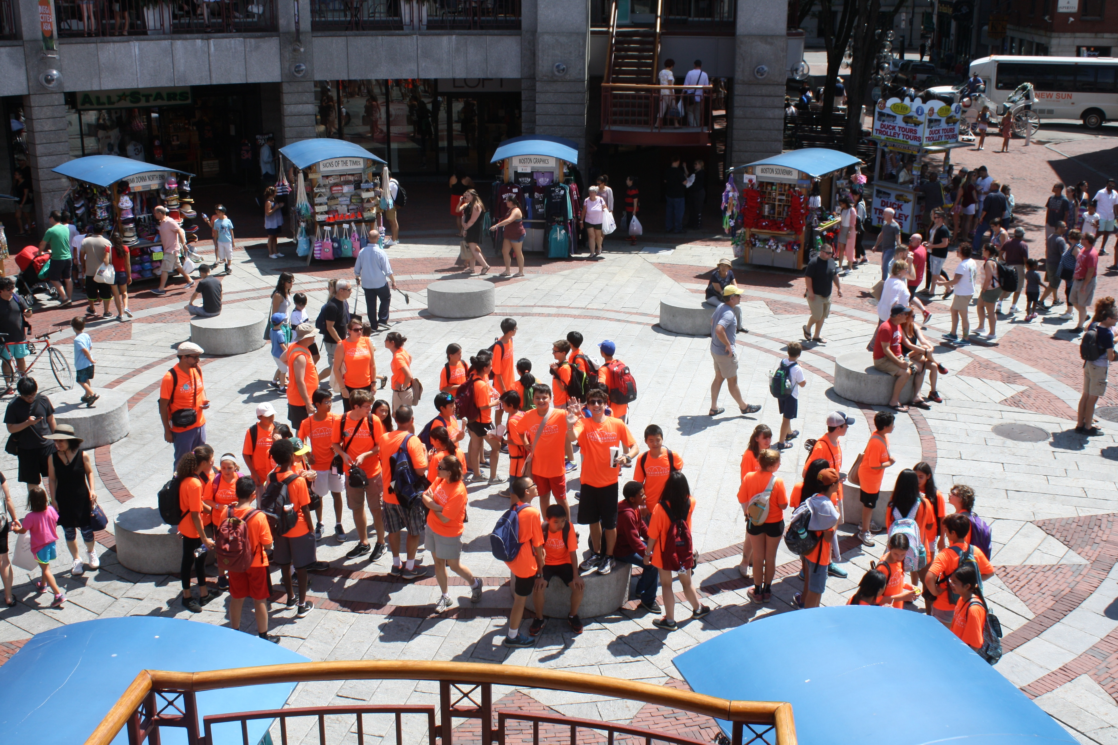 The Experimentory stands out bright orange amidst the mass of humanity in Quincy Market.