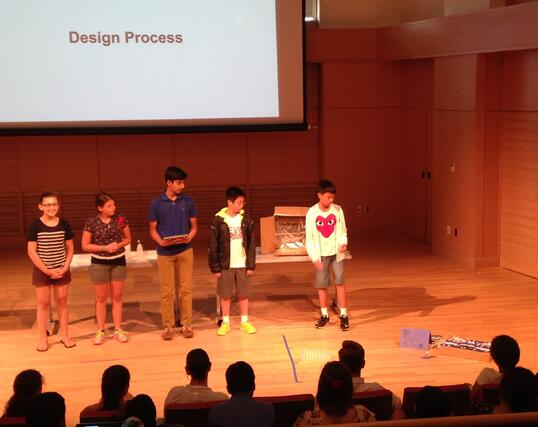 Students present an electronic carnival game they built and programmed themselves.