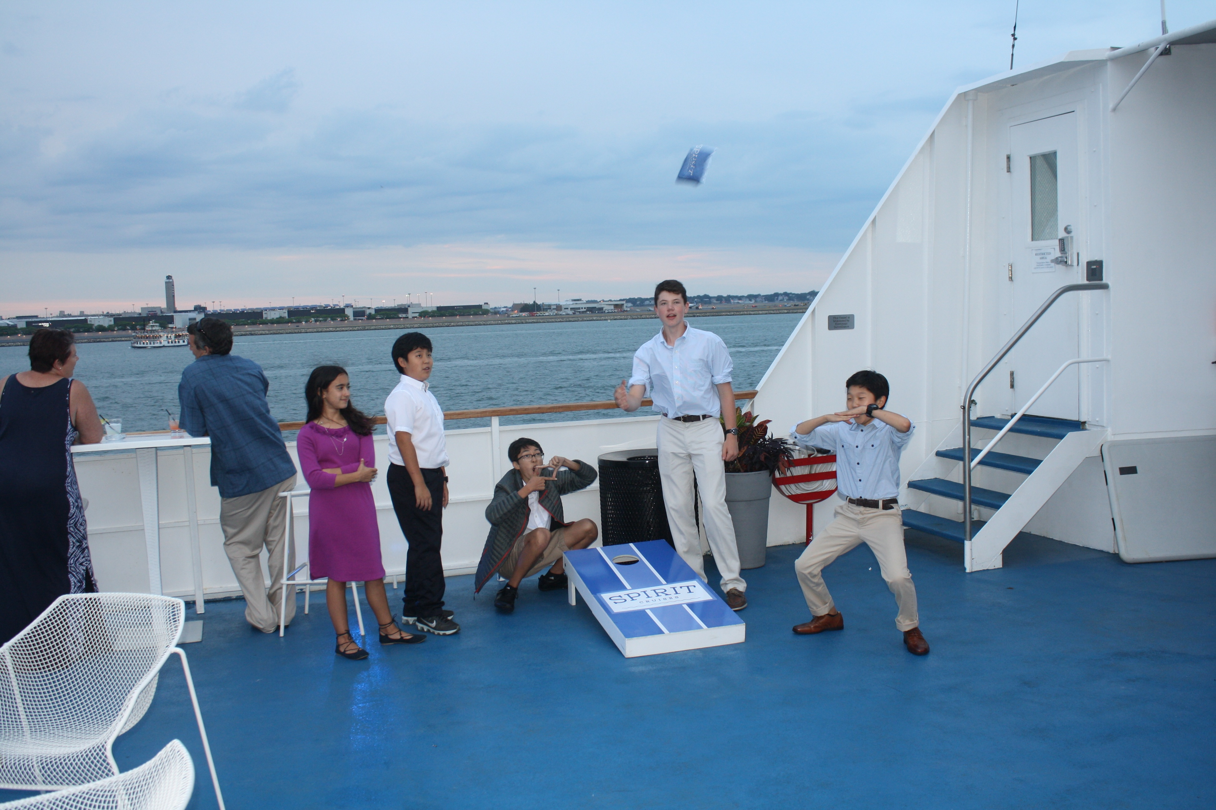 Seventh and Eighth toss bean bags on our Boston Harbor cruise