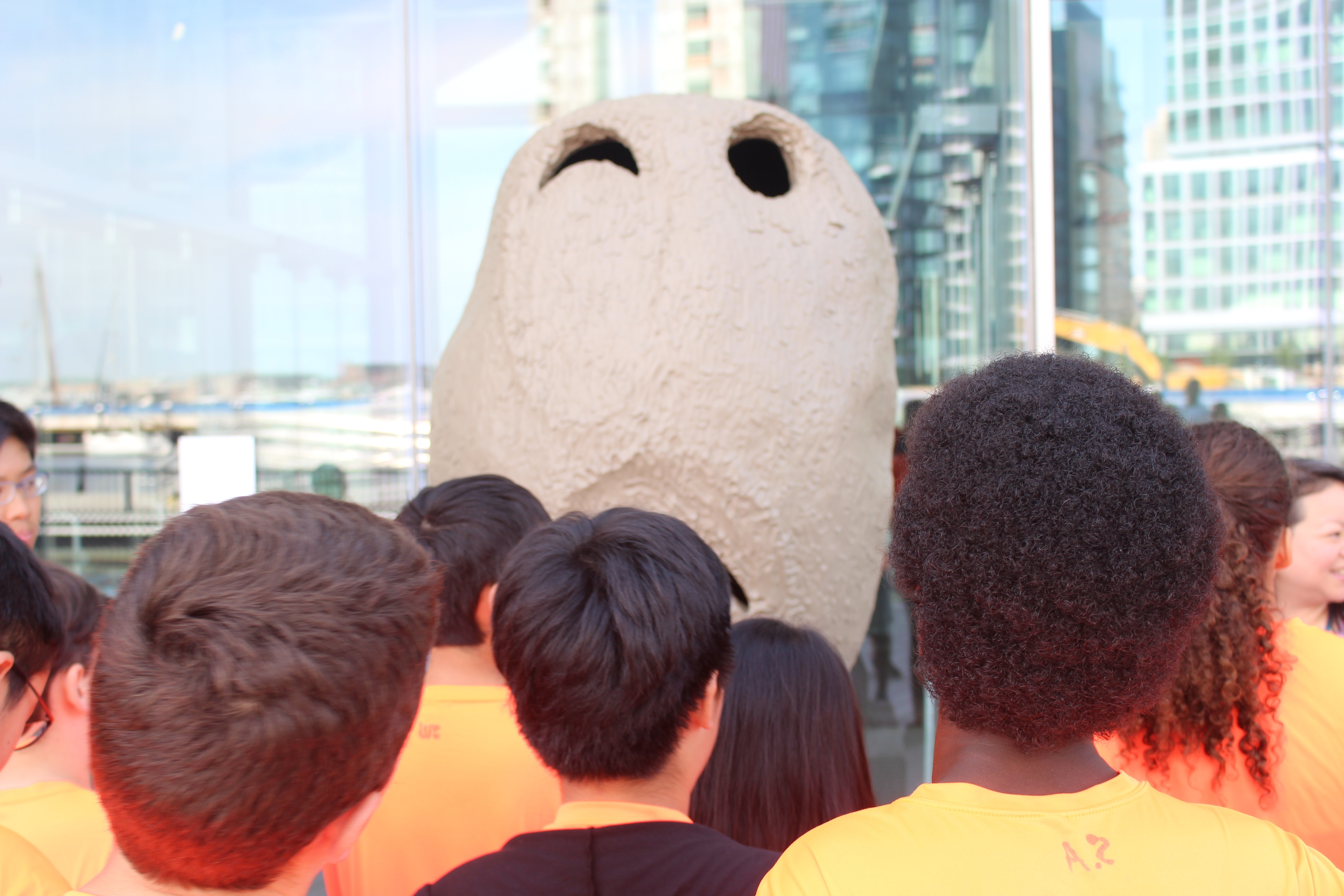 Middle schoolers admire and interpret a sculpture at the Museum of Contemporary Art