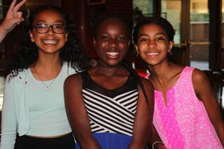 Three seventh grade girls pose at Exp17.