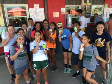 Exp16 students stopping for an ice cream on Deerfield Day.