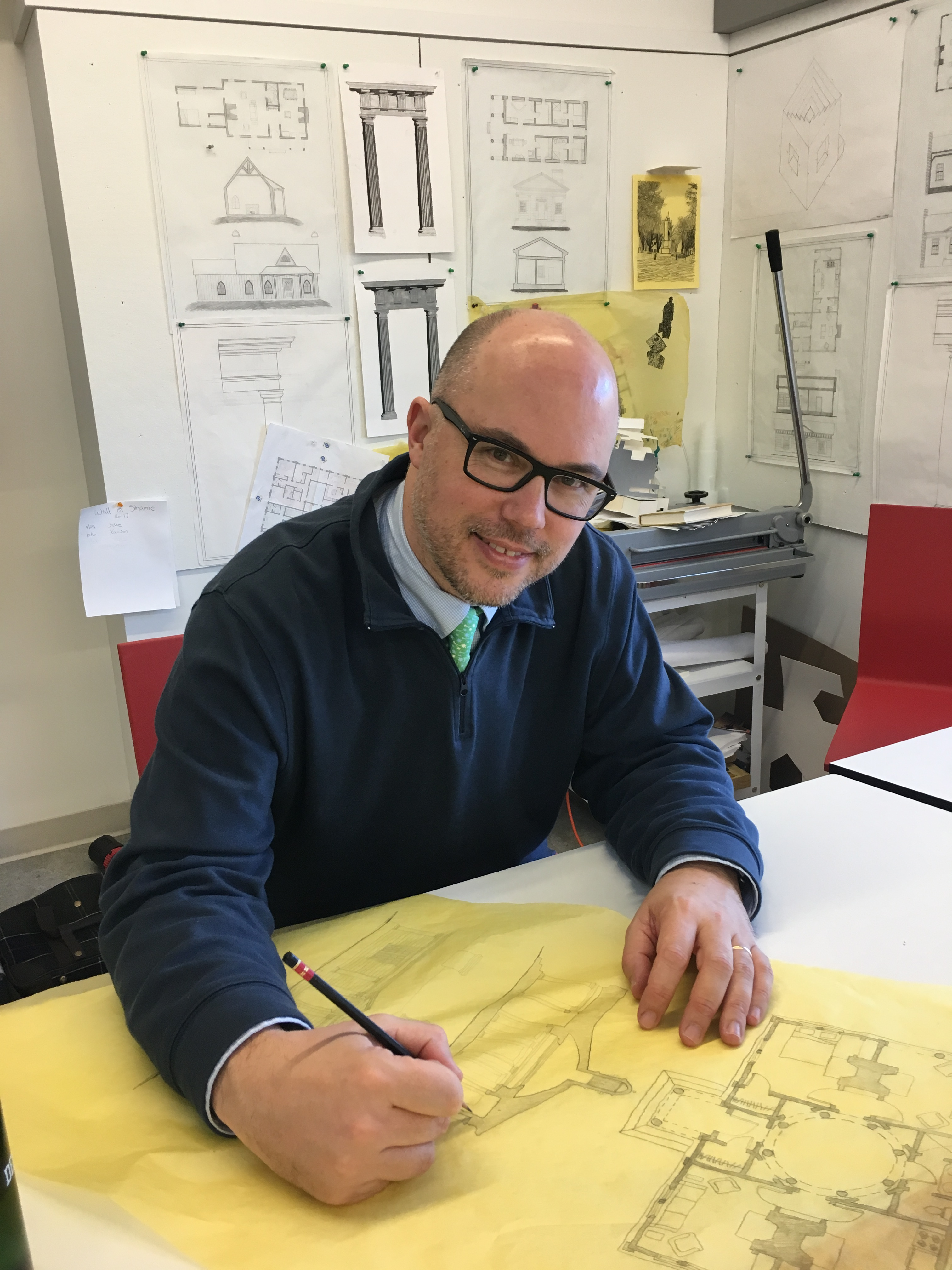 Mr. Payne at the Architecture drawing board in his classroom