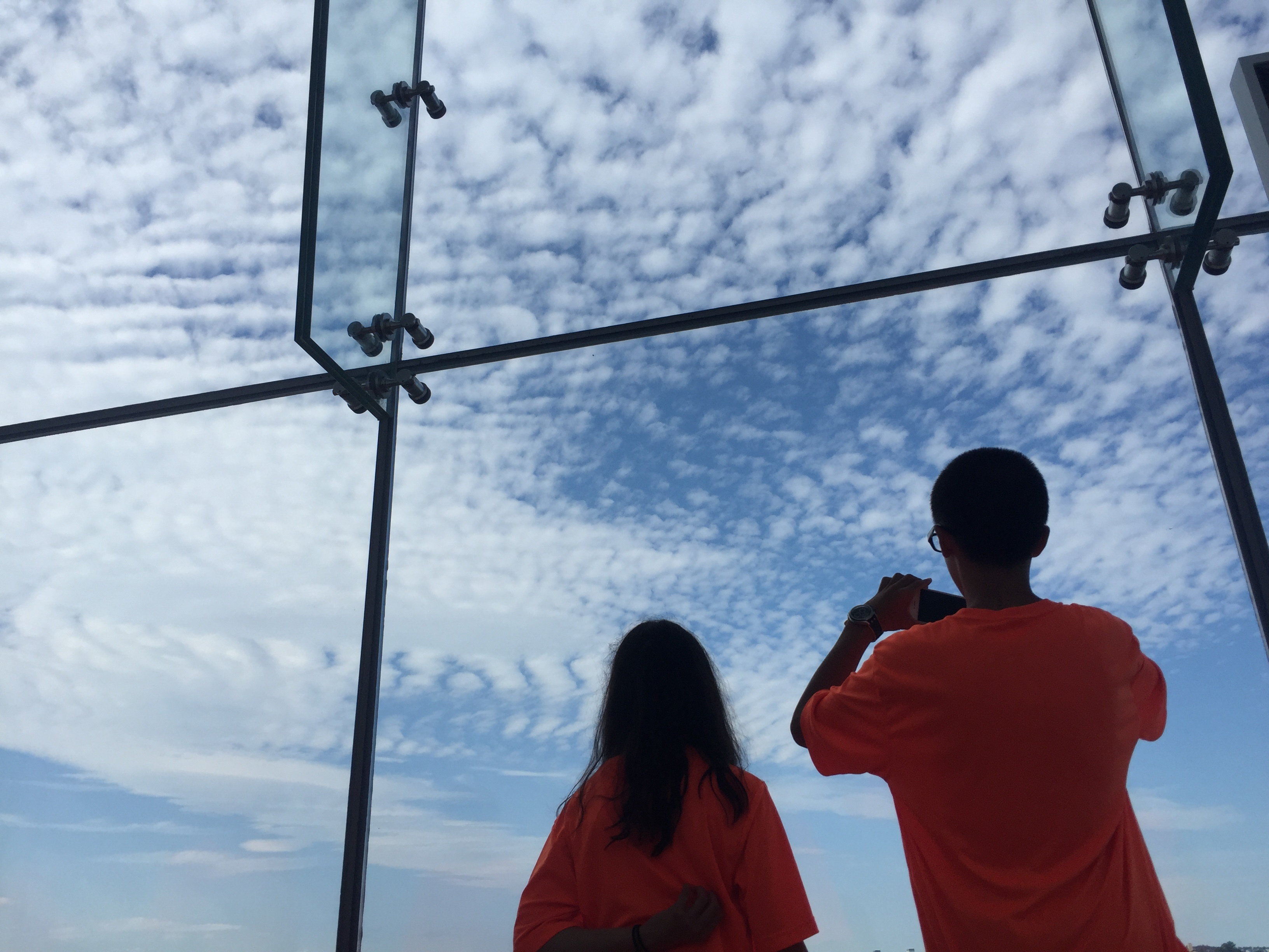 Students admire the blue skies of a beautiful clear day.