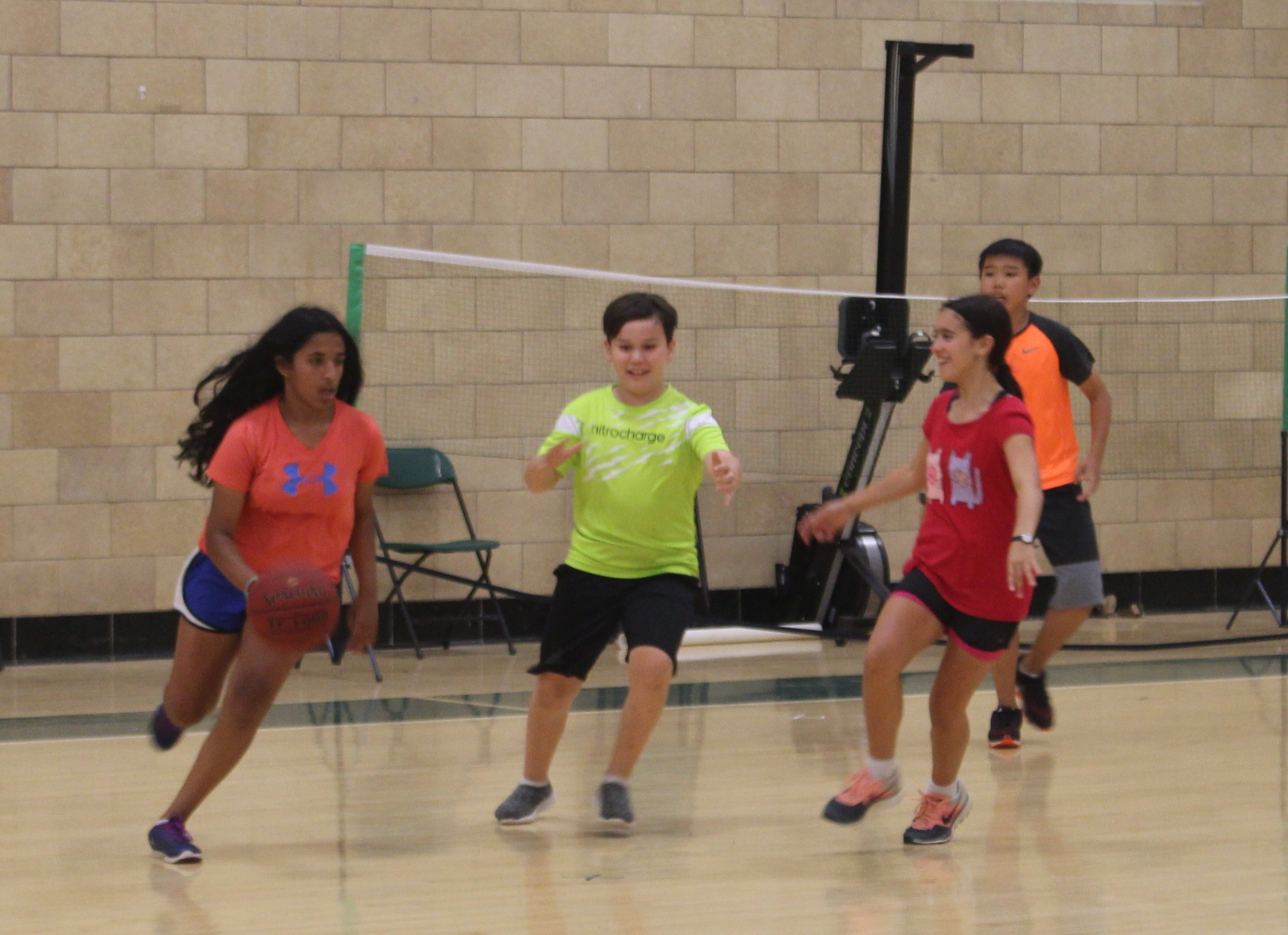Reshma rushes down court with some serious intensity!