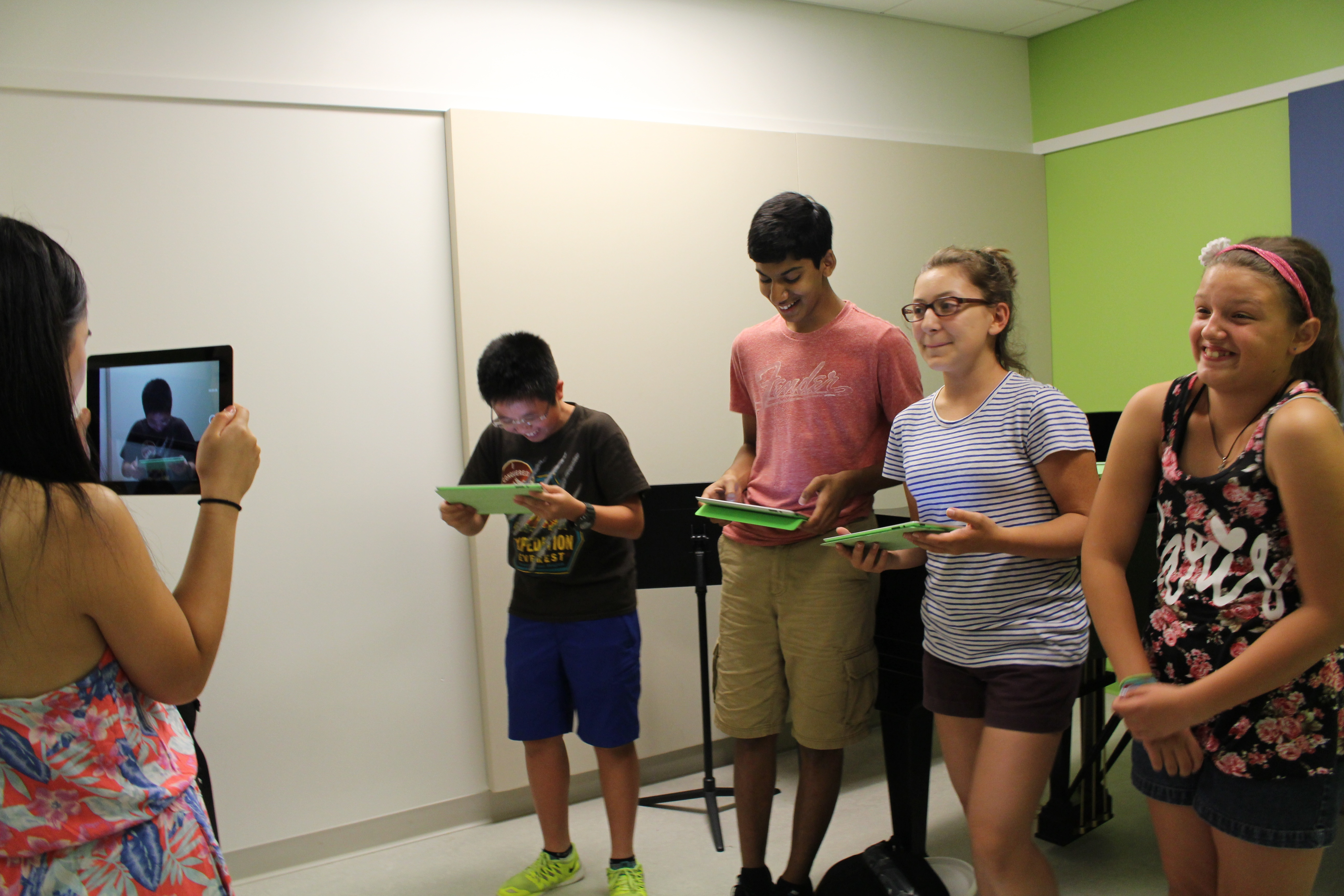 A group of students record a commerical promoting a device they invented at the Experimentory.