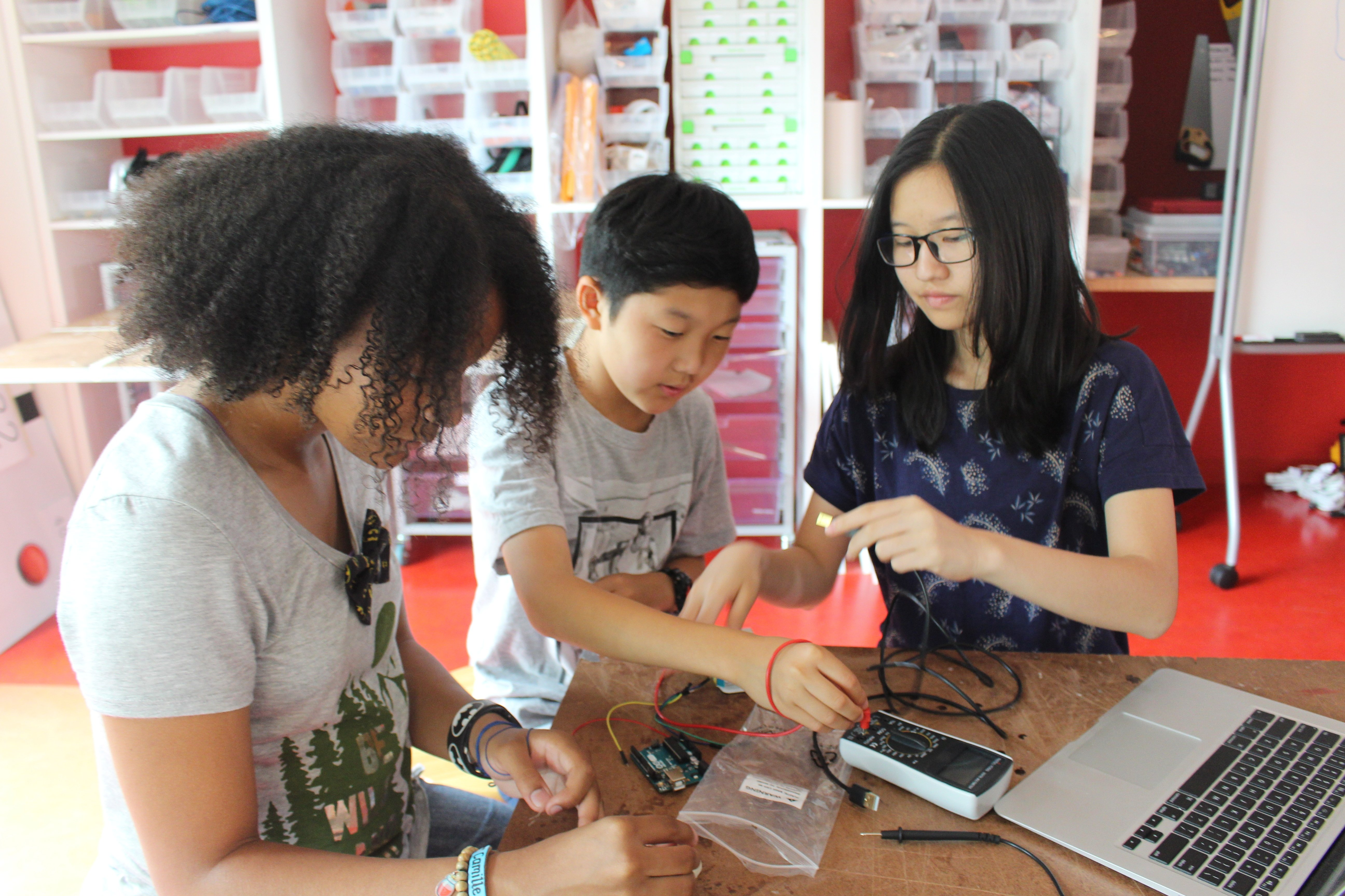 Seventh graders hard at work on an Electronics project.