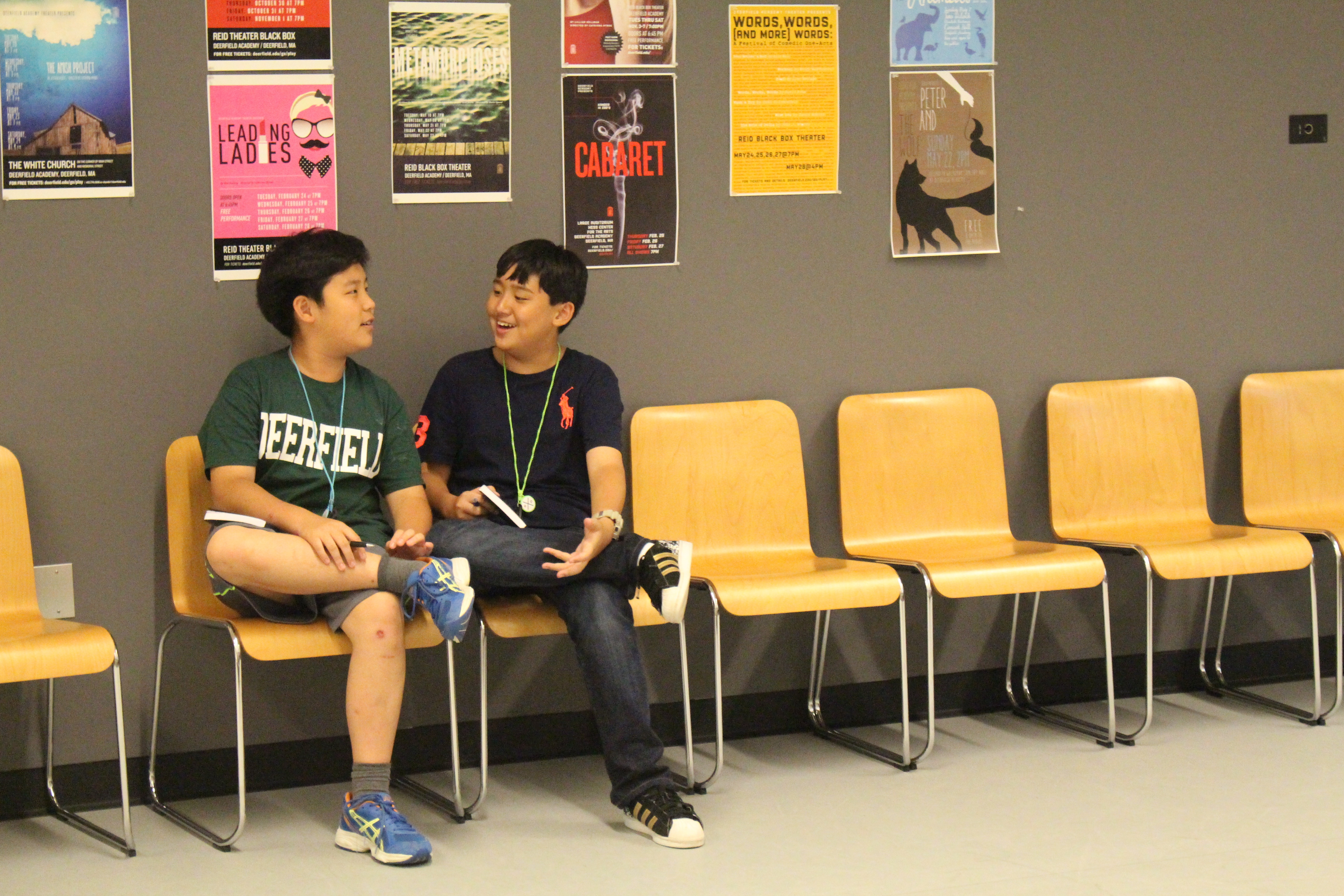 Brandon and Josh, seventh grade international students, practice their lines before a performance.