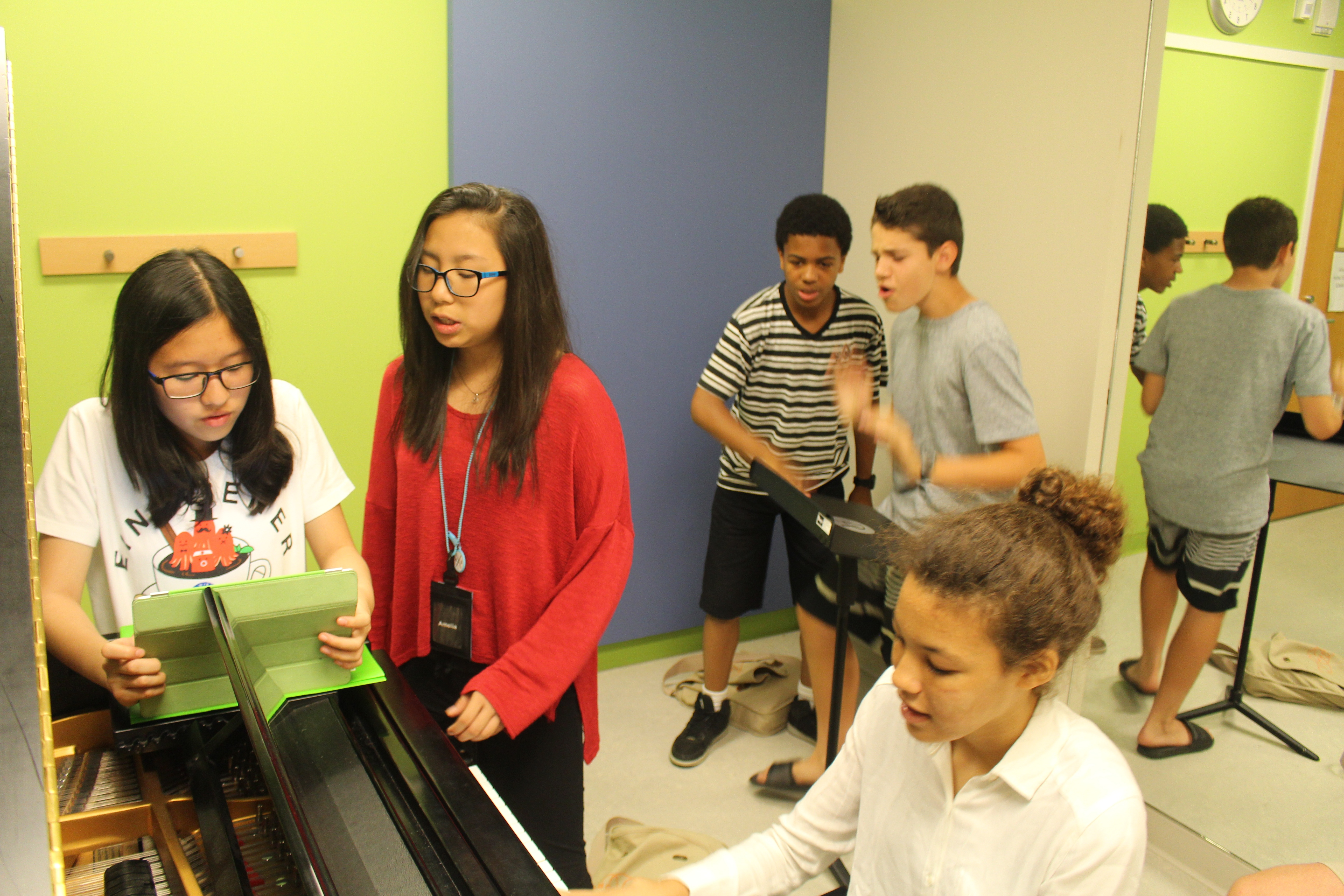 A student band rehearses in a Deerfield music practice room.
