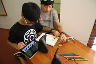 Middle school students collaborate on a visual music box